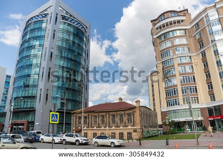 YEKATERINBURG, RUSSIA - AUG 07: Residential building of the merchant P.Florinsky - excelent example of Russian wooden architecture - on August 07, 2015 in Yekaterinburg, Russia. - stock photo