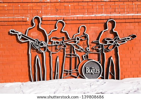YEKATERINBURG, RUSSIA - FEB 26: Monument to The Beatles on feb 26, 2012 in Yekaterinburg, Russia. Monument was installed on May 23, 2009, and this is the first monument to The Beatles in Russia. - stock photo