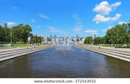 YEKATERINBURG, RUSSIA - JULY 21, 2015: Historical square with fountains on Iset river. Yekaterinburg was founded in 1723 and now it is the fourth-largest city in Russia with population of 1,428,042. - stock photo