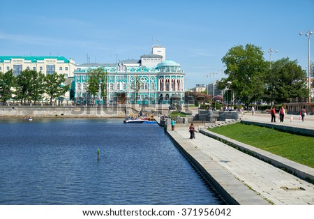 YEKATERINBURG, RUSSIA - MAY 26, 2015:   Iset river embankment on Lenin Prospekt with view on Home Sevastyanov and the administration building of the Governor of Sverdlovsk region, Ekaterinburg, Russia - stock photo
