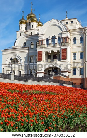 YEKATERINBURG, RUSSIA - MAY 26, 2015:  View of the Temple in the name of St. Nicholas in spring with blooming tulips in the foreground. Ekaterinburg, Russia - stock photo