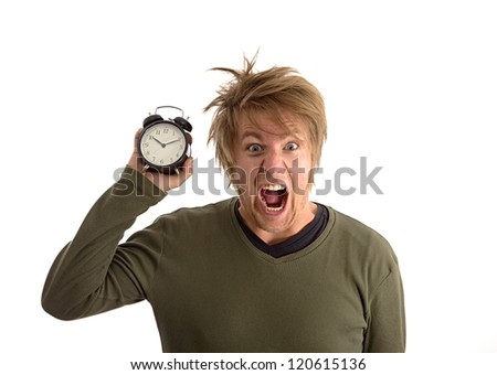 Yelling man with alarm clock in hand - stock photo