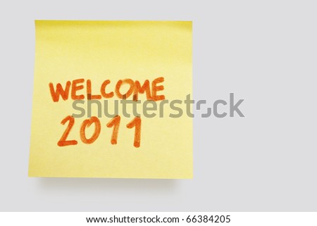 "yellow adhesive note on white background with ""welcome 2011"""