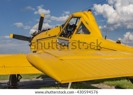 Yellow agricultural aircraft ready for flight, visible cockpit - stock photo