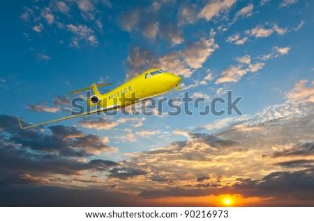 Yellow airplane over sunset - stock photo