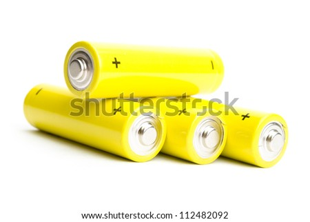 yellow alkaline batteries isolated on white background - stock photo