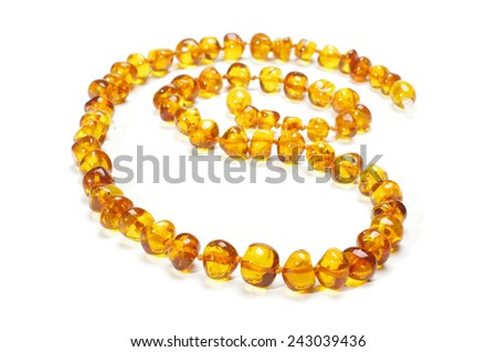 Yellow amber necklace isolated on the white background - stock photo