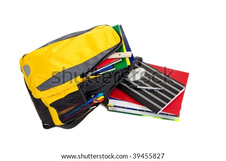 Yellow and black backpack with school supplies including composition books, notebooks, folders and text books on a white background - stock photo