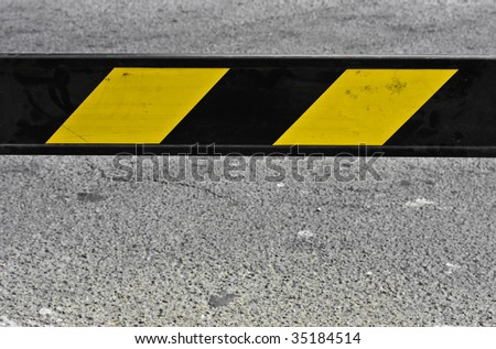 yellow and black barrier - stock photo
