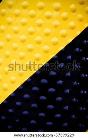 Yellow and black diagonal hazard stripes - stock photo