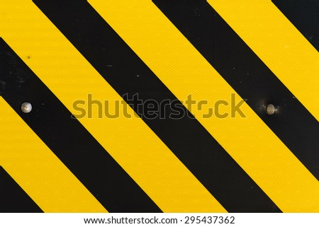 yellow and black pattern sign - stock photo
