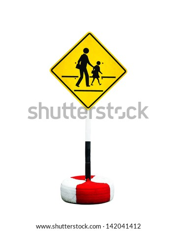 Yellow and black sign with a pedestrian crossing the road. - stock photo