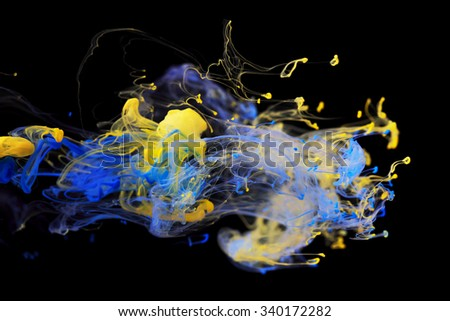 Yellow and blue color ink paint abstract pattern in water liquid