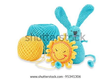 Yellow and blue toys and threads the same colors. Isolated on white. - stock photo