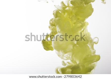 yellow and blue water ink in white background - stock photo