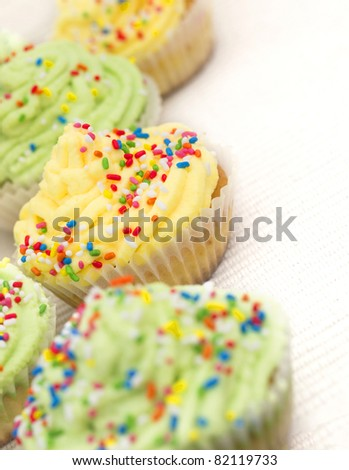 yellow and green cup cakes - stock photo