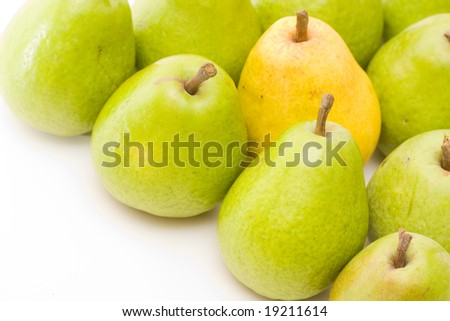 yellow and green pears on white with copy space