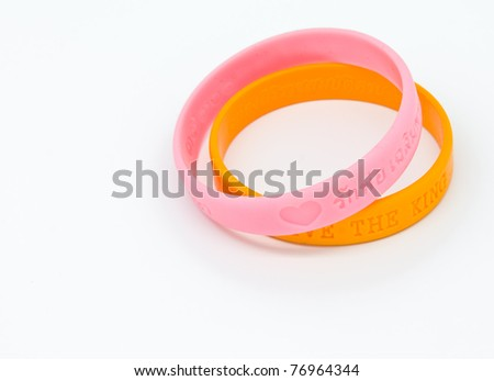 Yellow and pink rubber bracelet. Two colors of King of Thailand. - stock photo