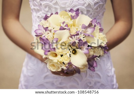 yellow and purple bride's bouquet - stock photo