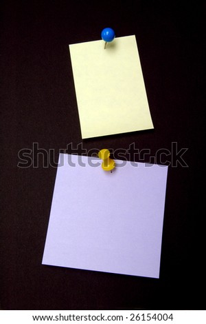 Yellow and purple notes with colored pushpins