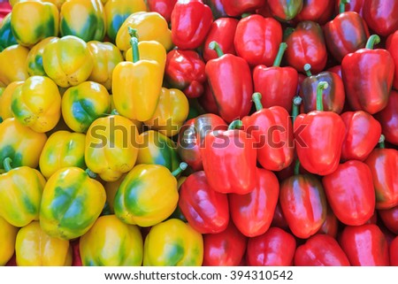 Yellow and red bell pepers close up in background - stock photo