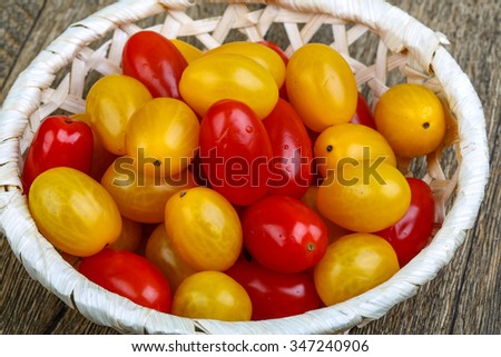 Yellow and red cherry tomatoes mix on the basket