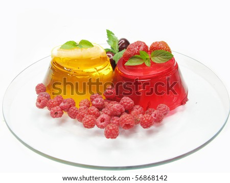 yellow and red fruit jelly dessert with raspberry and lemon - stock photo