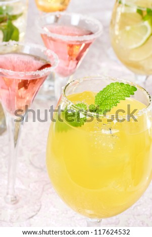 Yellow and red margaritas with salt and garnish - stock photo