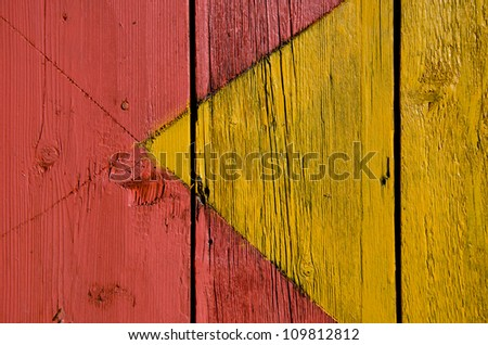yellow and red painted wooden board background and texture