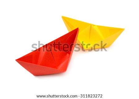 Yellow and red paper boats, origami