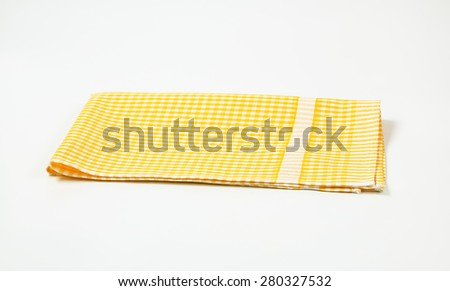 Yellow And White Checkered Tablecloth On White Background