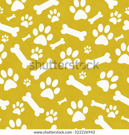 Yellow and White Dog Paw Prints and Bones Tile Pattern Repeat Background that is seamless and repeats - stock photo