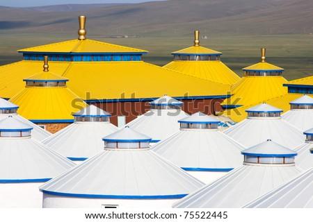 Yellow and white yurt at Inner Mongolia, China. - stock photo