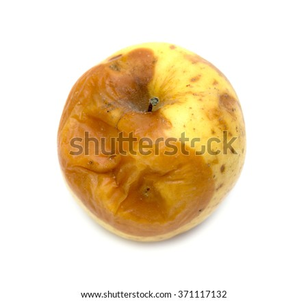 yellow apple with a mold on a white background
