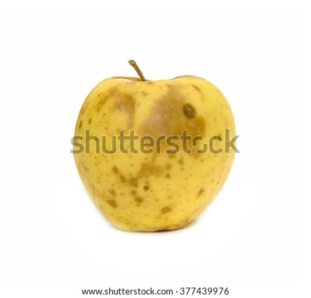yellow apple with a mold on a white background - stock photo