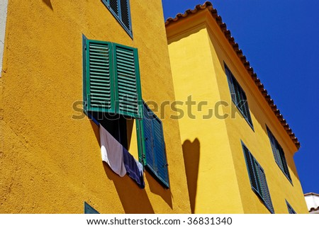 Yellow architecture of small Lloret de Mar city. Costa Brava, Spain.