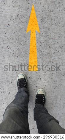 Yellow arrow - stock photo
