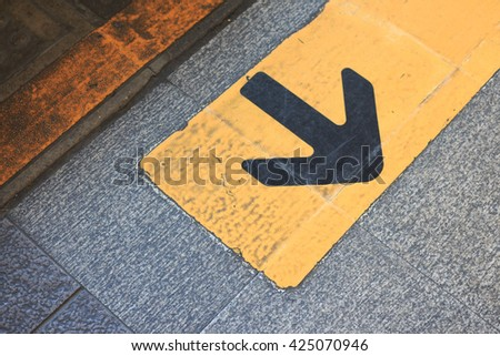 yellow arrow direction sign on asphalt ,opportunity choice for turn back - stock photo