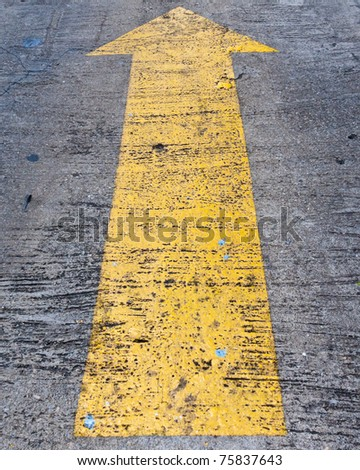 Yellow arrow to indicate the travel of the arrow background - stock photo