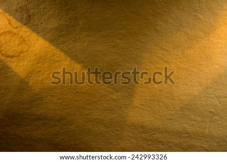 Yellow background illuminated from the left and right corner spotlight and vintage grunge background texture - stock photo