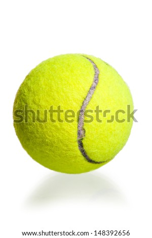 yellow ball for the game of tennis on a white background - stock photo