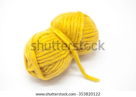 Yellow ball of wool yarn for knitting close up on a white background - stock photo