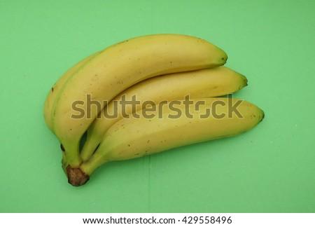Yellow banana (Musa acuminata balbisiana paradisiaca) fruit vegan food - stock photo