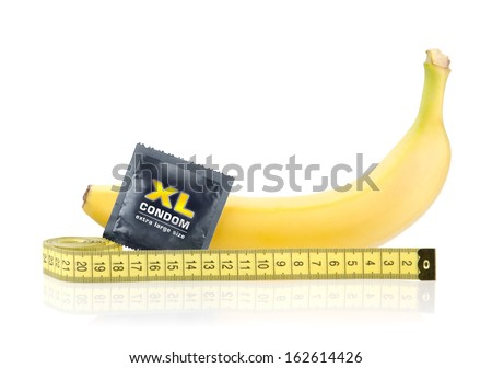 Yellow Banana with Condom and Measuring Tape Isolated on White Background - stock photo