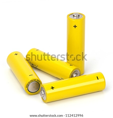 Yellow battery isolated on white background - stock photo