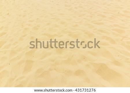 Yellow beach sand as background - stock photo