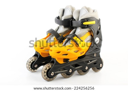 Yellow & Black Colored roller skates isolated on white  - stock photo