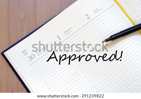 Yellow blank notepad on office wooden table and text concept - stock photo