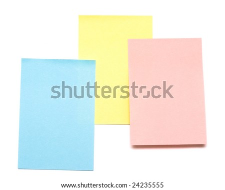 yellow, blue and pink pages of notebook on white - stock photo