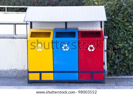 Yellow Blue and Red Recycle Bin - stock photo